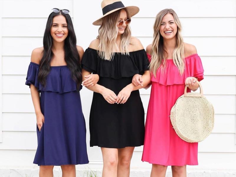 Girls smiling wearing dresses