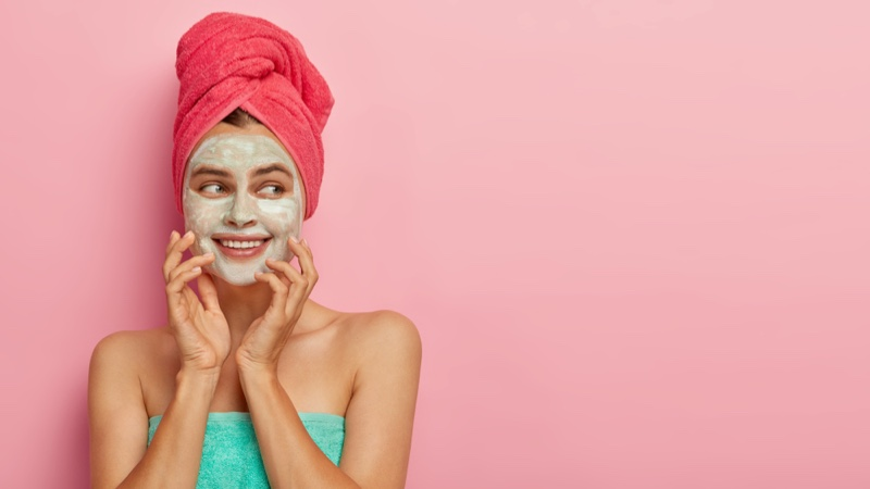 Smiling Woman Green Face Mask Towels Beauty