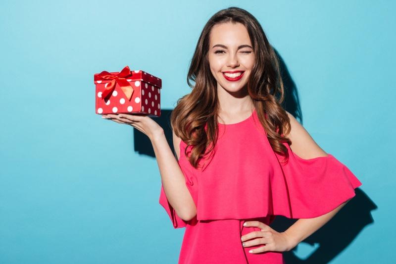 Smiling Woman Polka Dot Print Gift Box Pink Dress