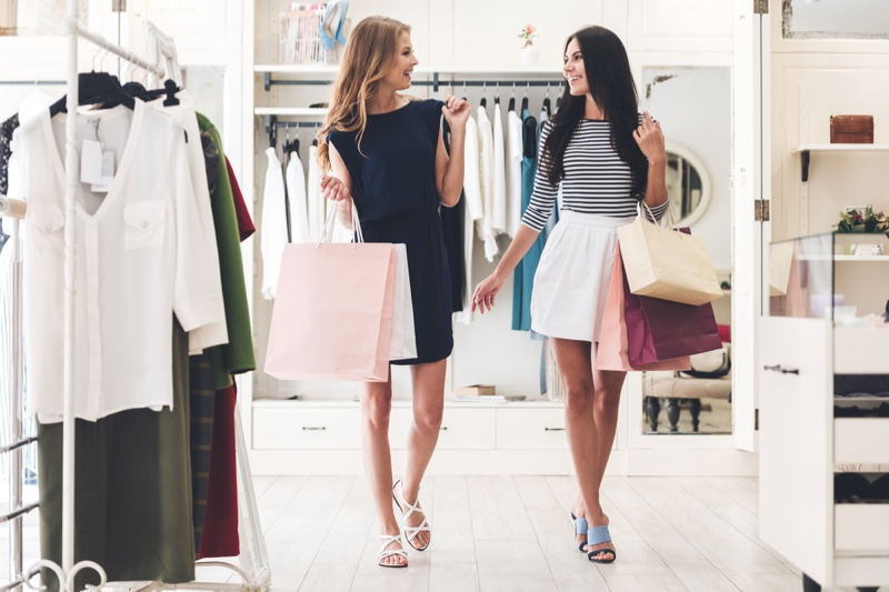 Two Women Friends Shopping Clothing Store Bags