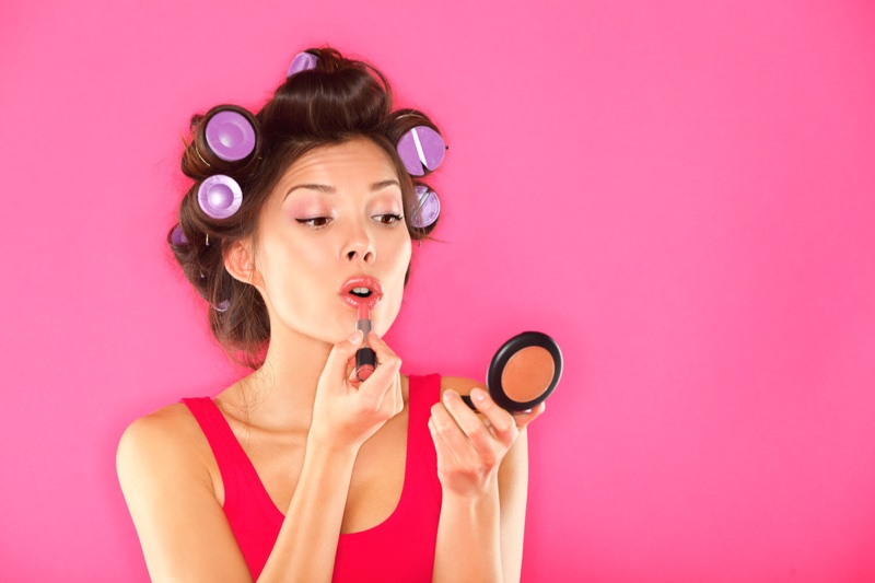 Woman Applying Makeup Rollers Hair Compact