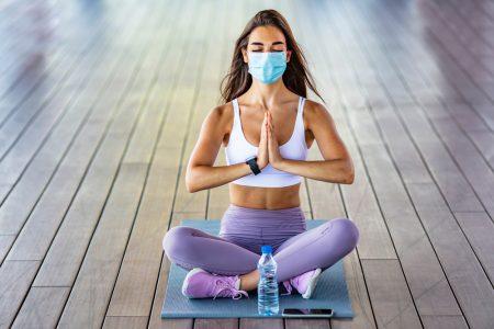 Woman During Yoga Wearing Mask