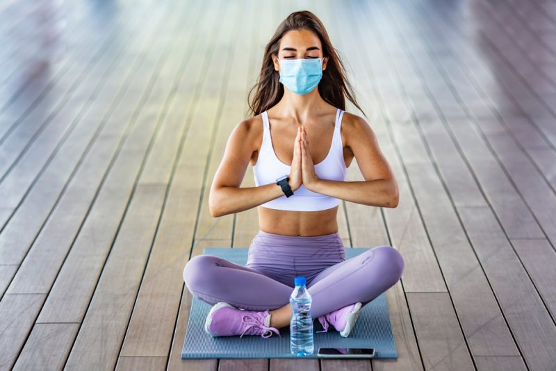 Woman During Yoga Wearing Mask