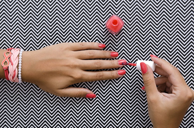 Woman Painting Nails Pink Chevron Background