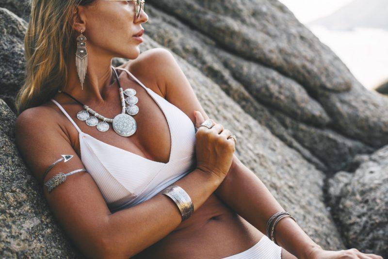 Woman in Bikini at Beach Wearing Silver Jewelry