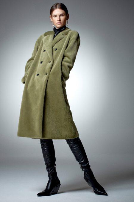 Giedre Dukauskaite poses in Zara faux fur wrap coat.