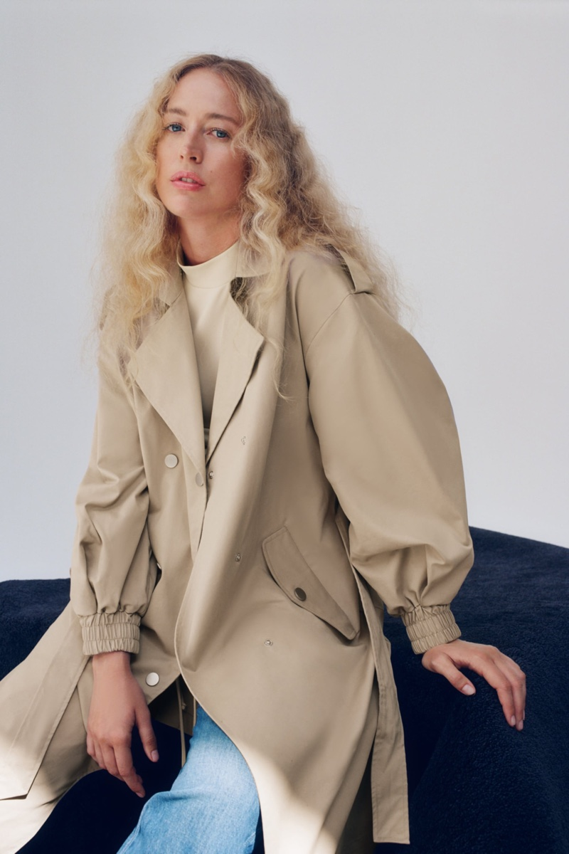 Raquel Zimmermann poses in Zara long trench coat with elasticized cuffs.