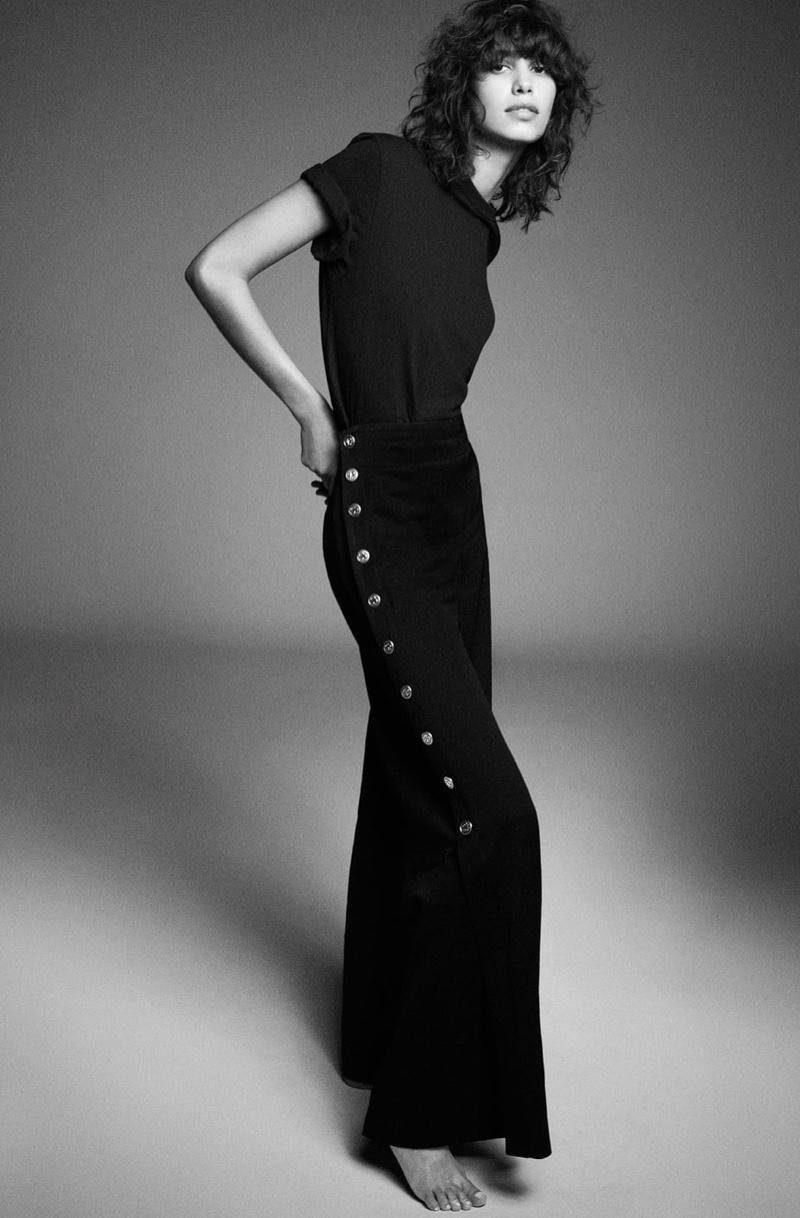 Model Mica Arganaraz poses in Zara shirt and wide leg trousers.