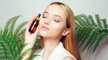 Beauty Model Holding Oil Bottle Plants Natural Smiling