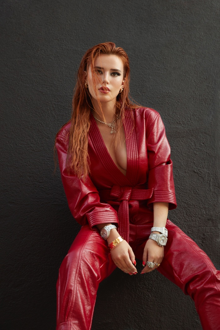 Dressed in red, Bella Thorne wears a leather look.