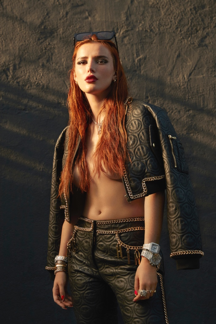 Rocking chains and leather, Bella Thorne poses topless.