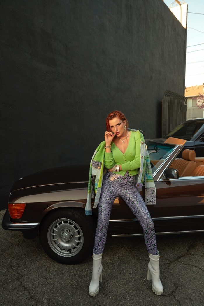 Posing with a convertible, Bella Thorne rocks an eclectic look.