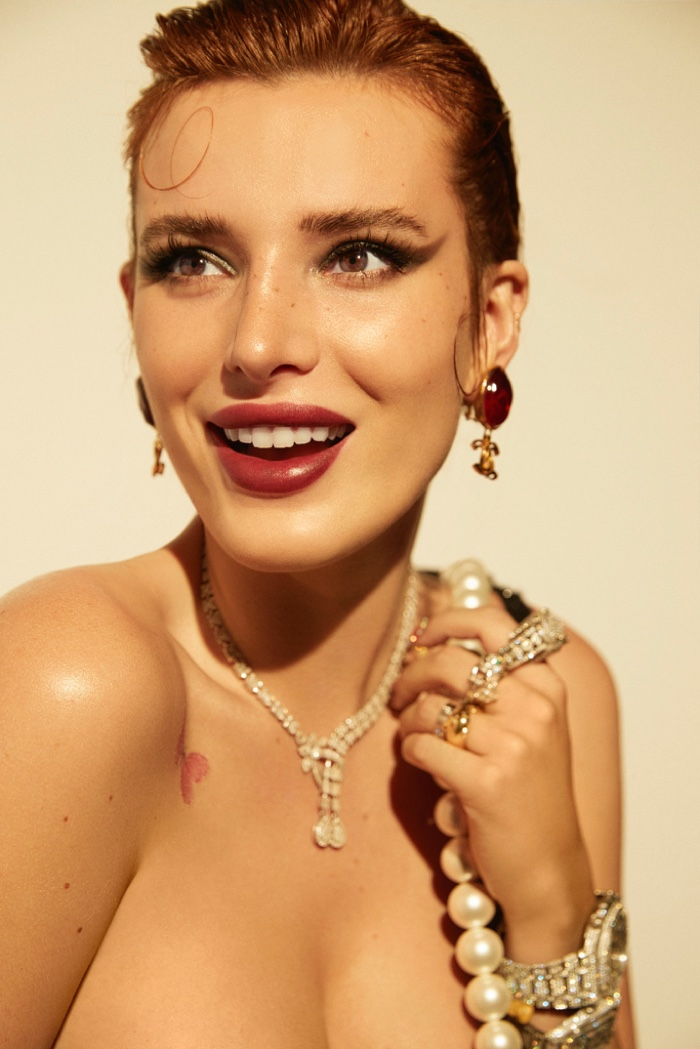 All smiles, Bella Thorne wears a Chanel look.