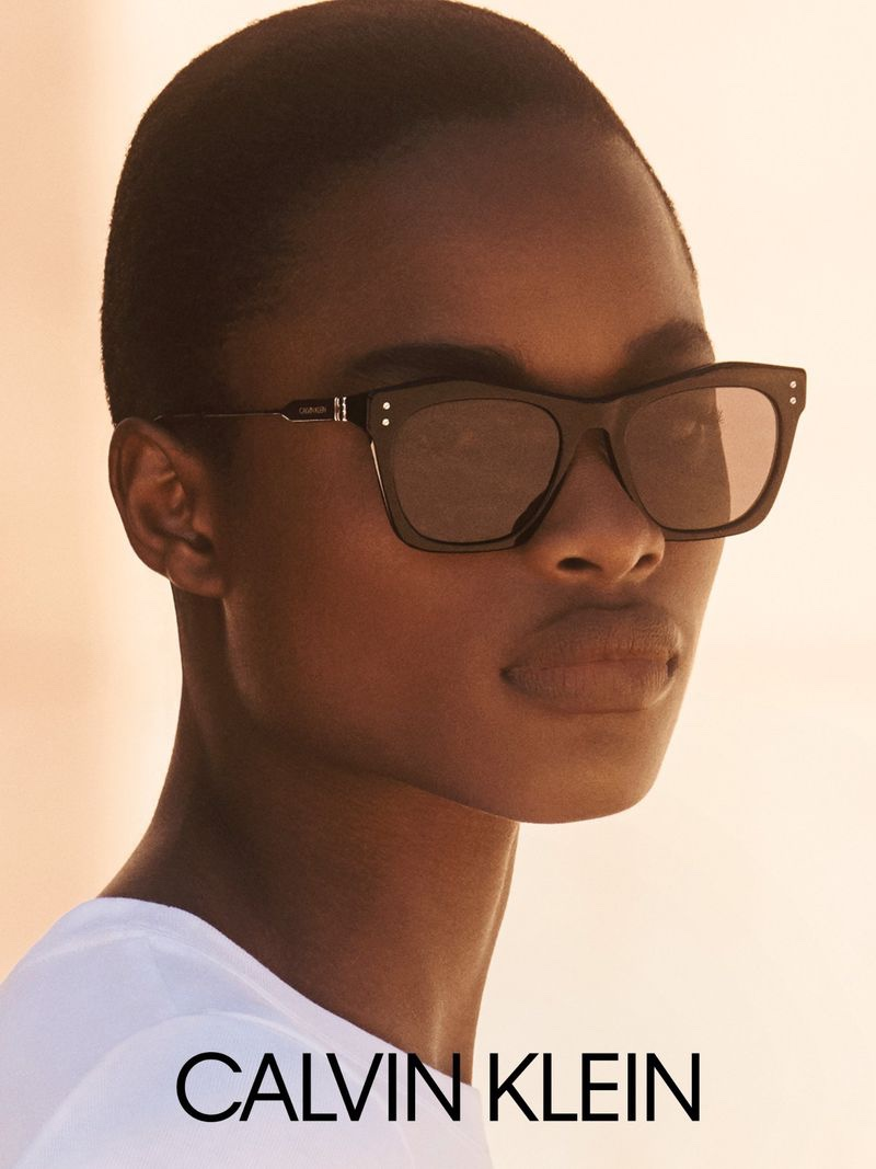 Mayowa Nicholas wears chic sunglasses in Calvin Klein fall-winter 2020 campaign.