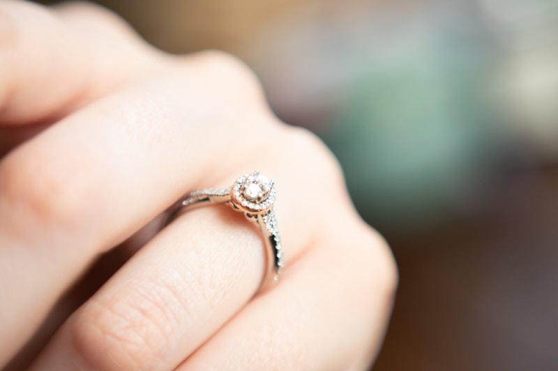 Closeup Oval Engagement Halo Diamond Ring Hand