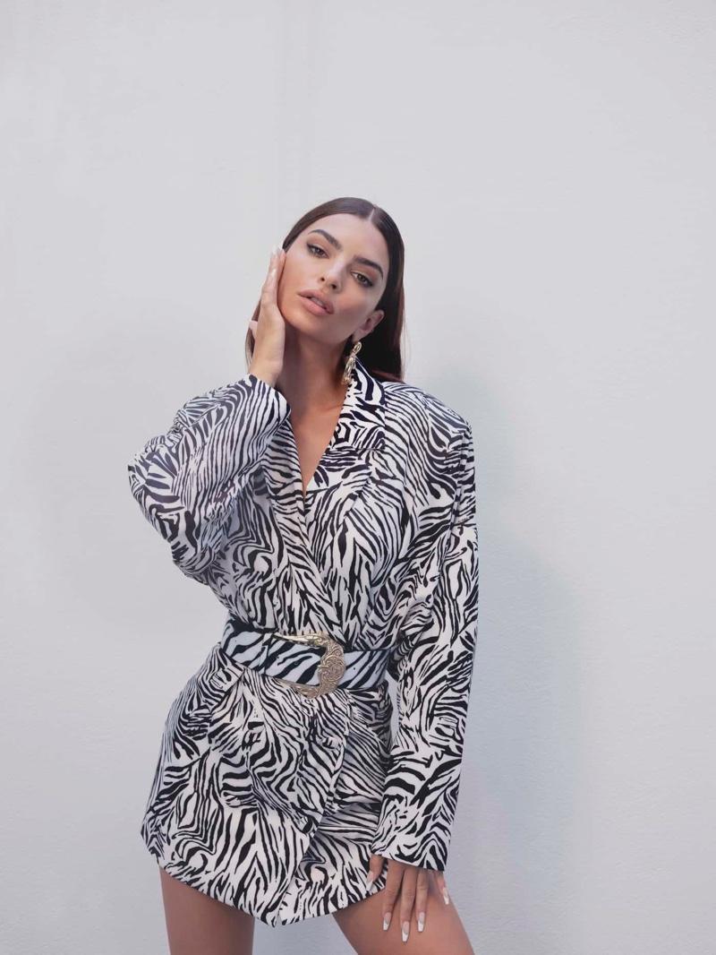 Emily Ratajkowski models Nasty Gal x EMRATA zebra print blazer dress.