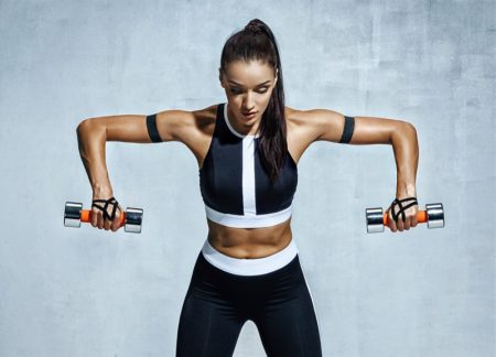 Fitness Model Holding Using Weights Workout
