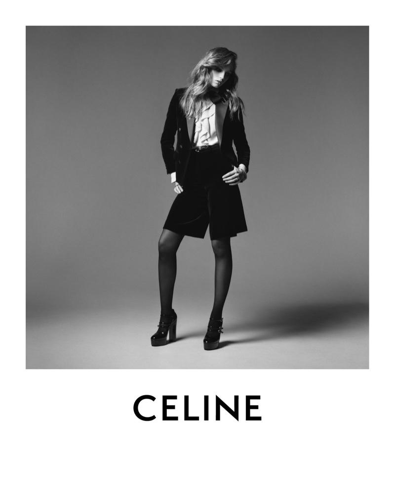 Fran Summers models black velvet tuxedo jacket and Bermuda shorts from Celine winter 2020 collection.