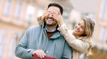 Girlfriend Covering Man's Eyes Gift Smiling Couple Happy