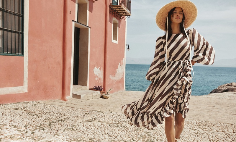 Standing out in stripes, Irina Shayk fronts Zimmermann resort swim 2021 campaign.