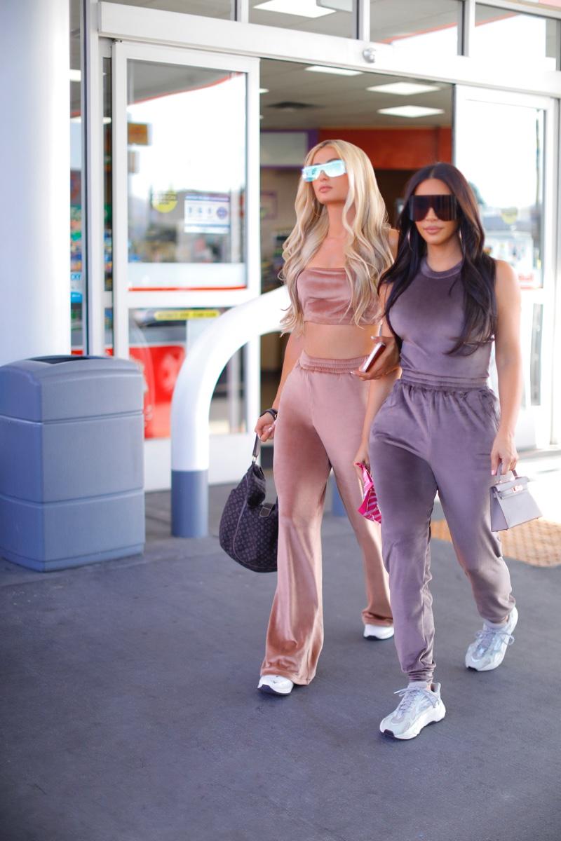 Going for a candid stroll, Kim Kardashian and Paris Hilton wear SKIMS velour collection.