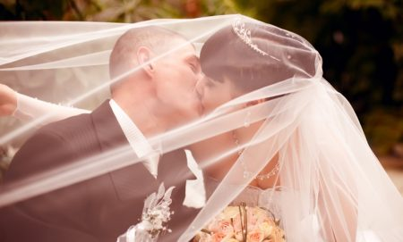 Kissing Bride Groom Under Veil Romantic
