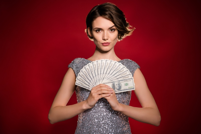 Model Holding Fanned Money Hundred Bills Silver Sequin Dress