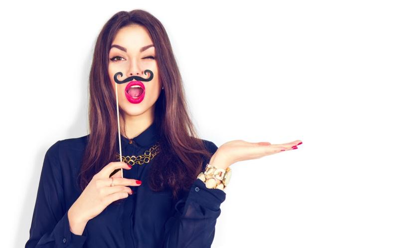 Model Holding Mustache Fun Whimsical Fashion