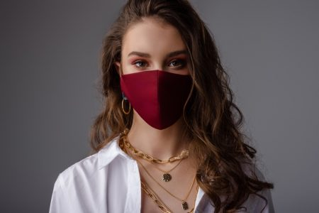 Model Wearing Mask Jewelry Layered Necklaces Wavy Long Hair