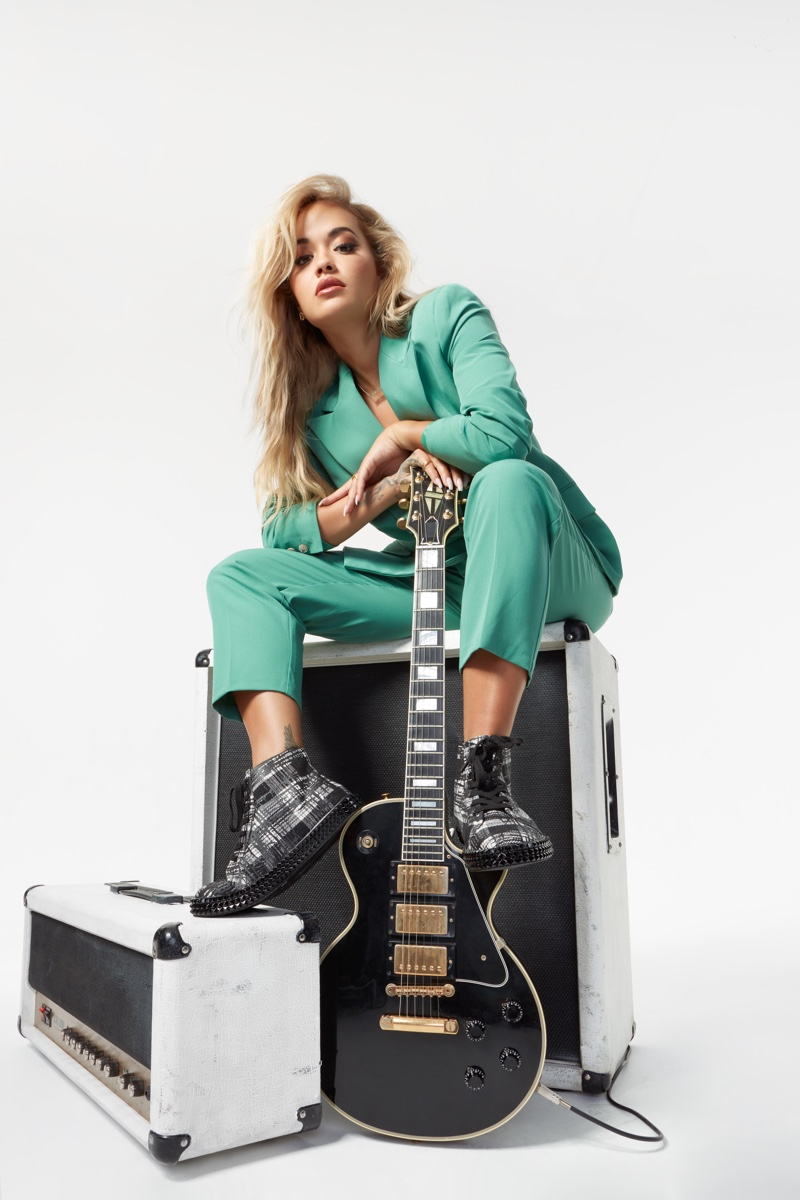 Suiting up, Rita Ora poses for ShoeDazzle campaign.