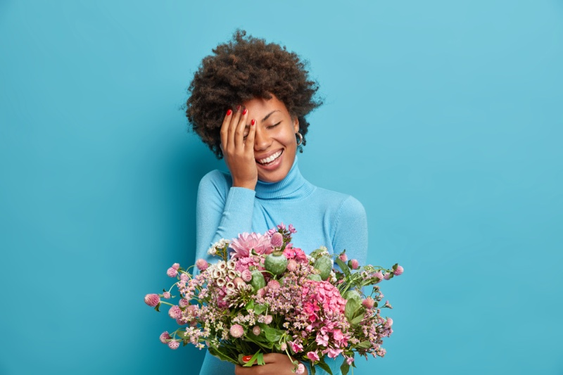 Smiling Afro Model Holding Bouquet Flowers Gift