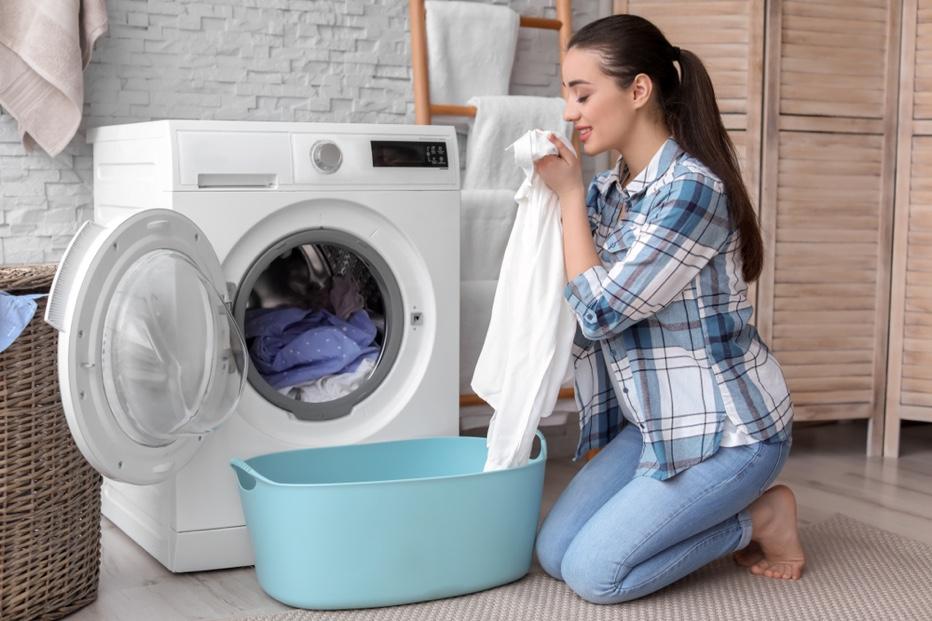 Smiling Woman Doing Laundry Washing Machine