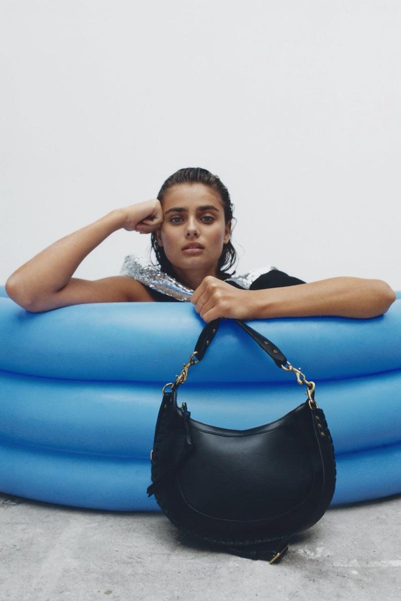 Taylor Hill poses with Isabel Marant Naoko bag.
