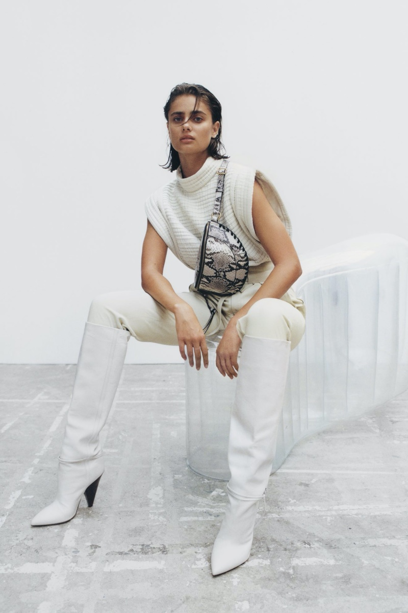 Dressed in white, Taylor Hill fronts Isabel Marant fall-winter 2020 accessories collection.