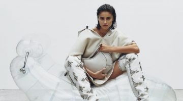 Model Taylor Hill wears Isabel Marant Naoko bag with Lyork boots.