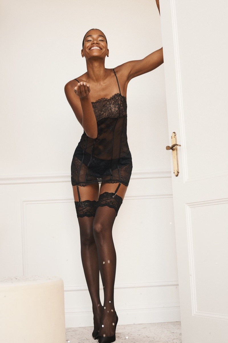 Arlenis Sosa wears Victoria's Secret Mixed Sheer Lace Mini Slip & Thigh-Highs.