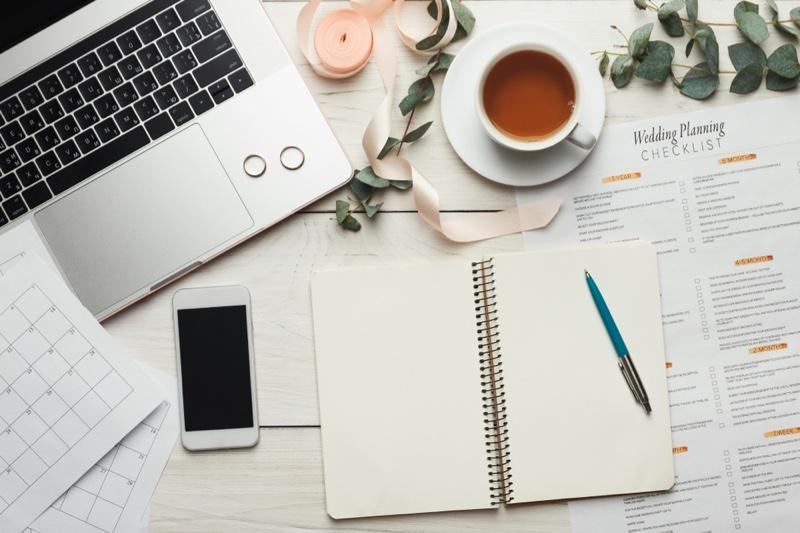 Wedding Planning Checklist Laptop Rings Tea Cup Phone Notebook