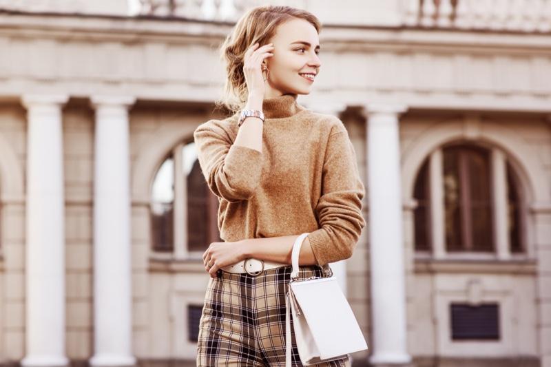 Woman Brown Sweater Pants White Bag