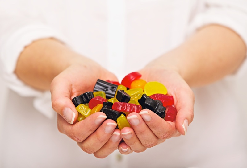 Woman Holding Multicolored Gummies Hands