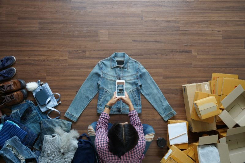 Woman Taking Picture of Denim Jacket