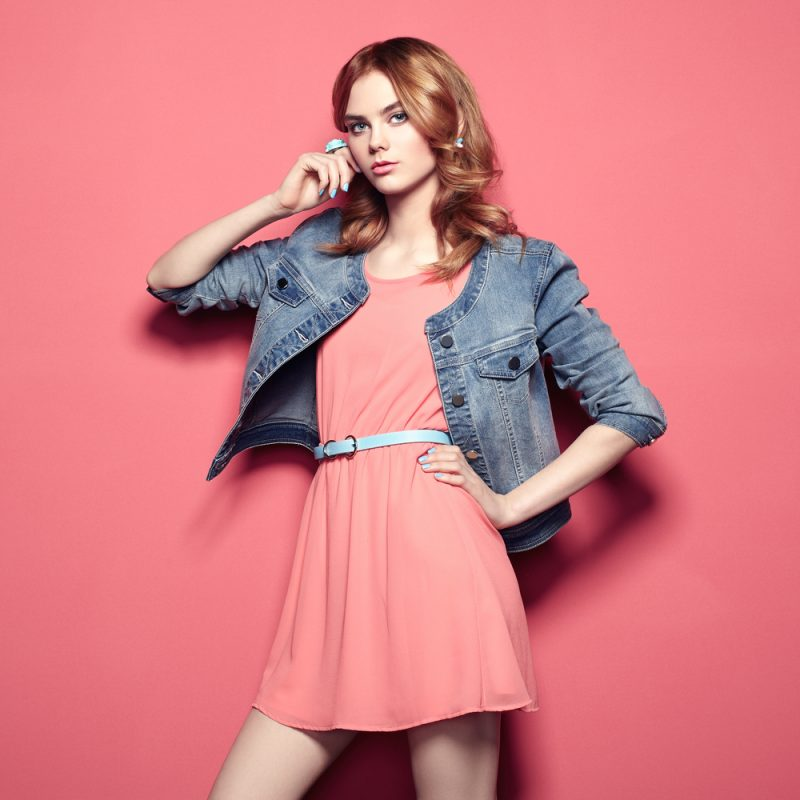 Woman in Denim Jacket and Coral Dress
