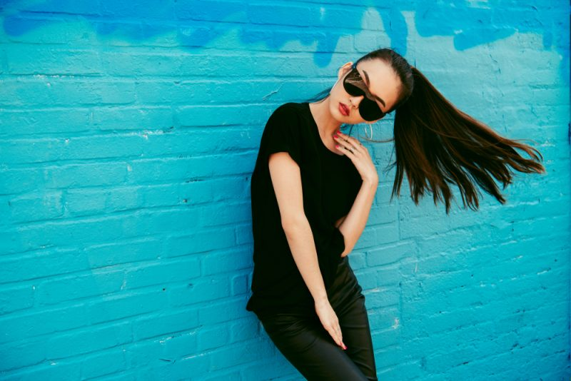Woman in Sunglasses and Black T-Shirt