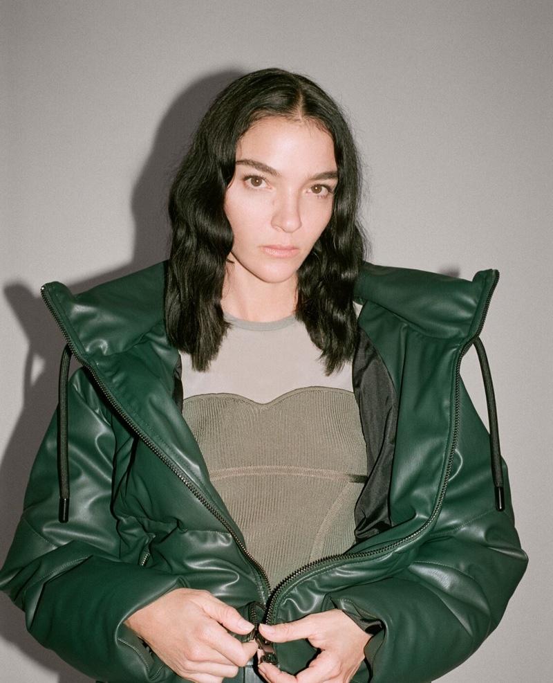 Dressed in green, Mariacarla Boscono wears Zara's faux leather styles.