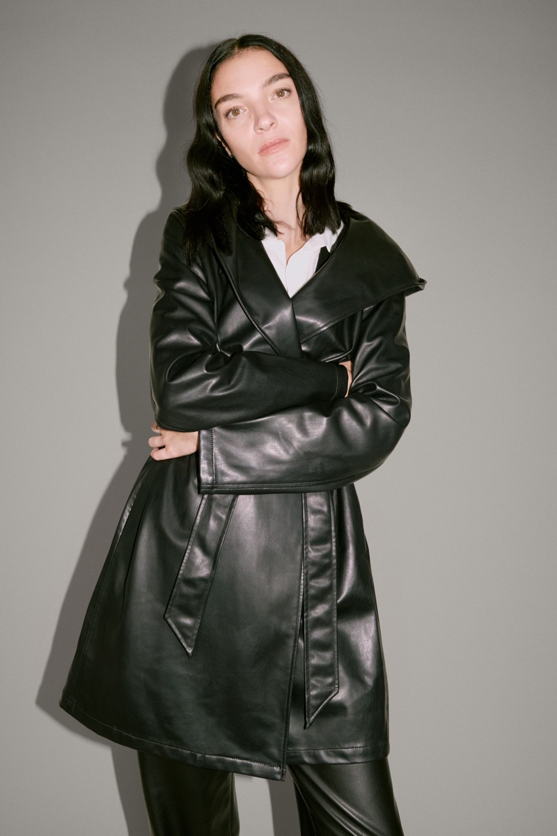 Mariacarla Boscono poses in Zara hooded faux leather coat.