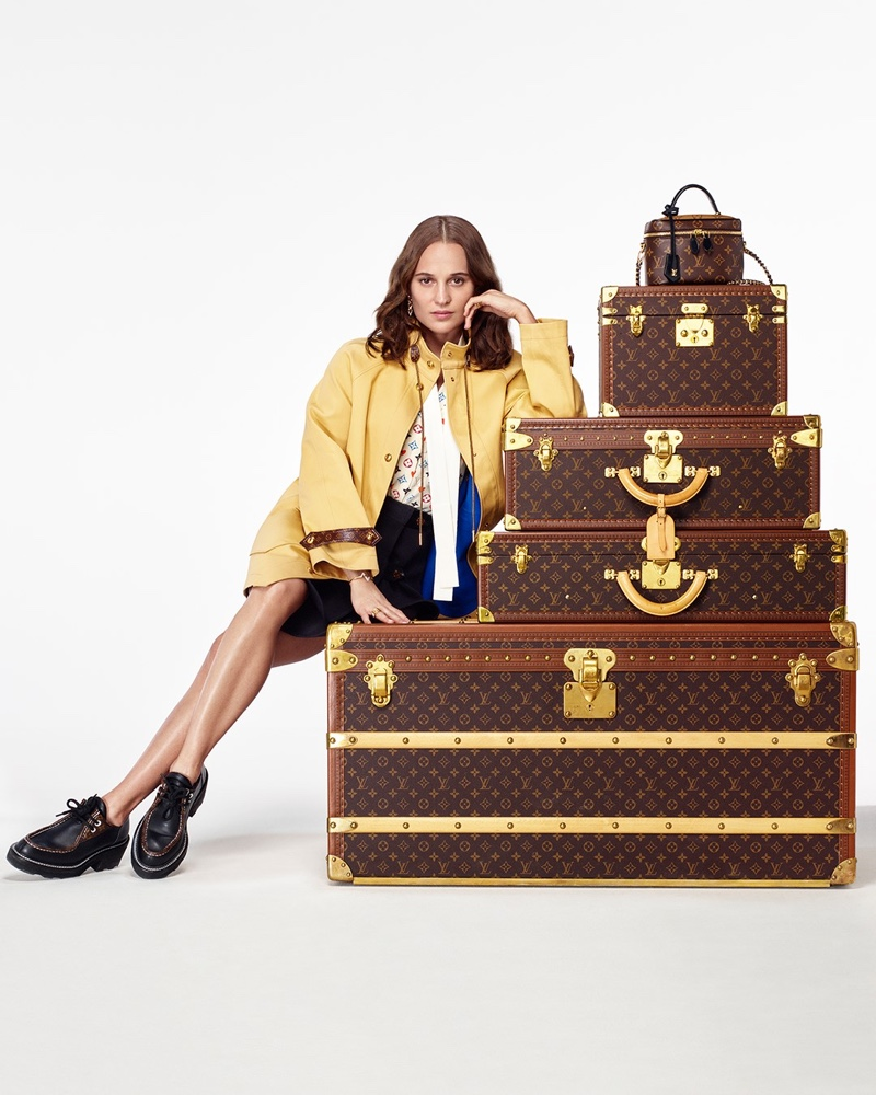 Ready for travel, Alicia Vikander stirs up envy as she poses with Louis Vuitton monogram luggage trunks for the brand's holiday 2020 campaign.