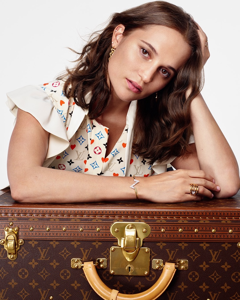 Actress Alicia Vikander wears a multicolor monogram Louis Vuitton blouse for the French fashion house's holiday 2020 campaign.