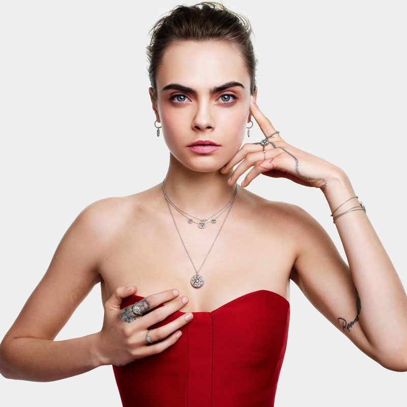 Wearing red, Cara Delevingne is the face of Dior Joaillerie's Christmas 2020 campaign.