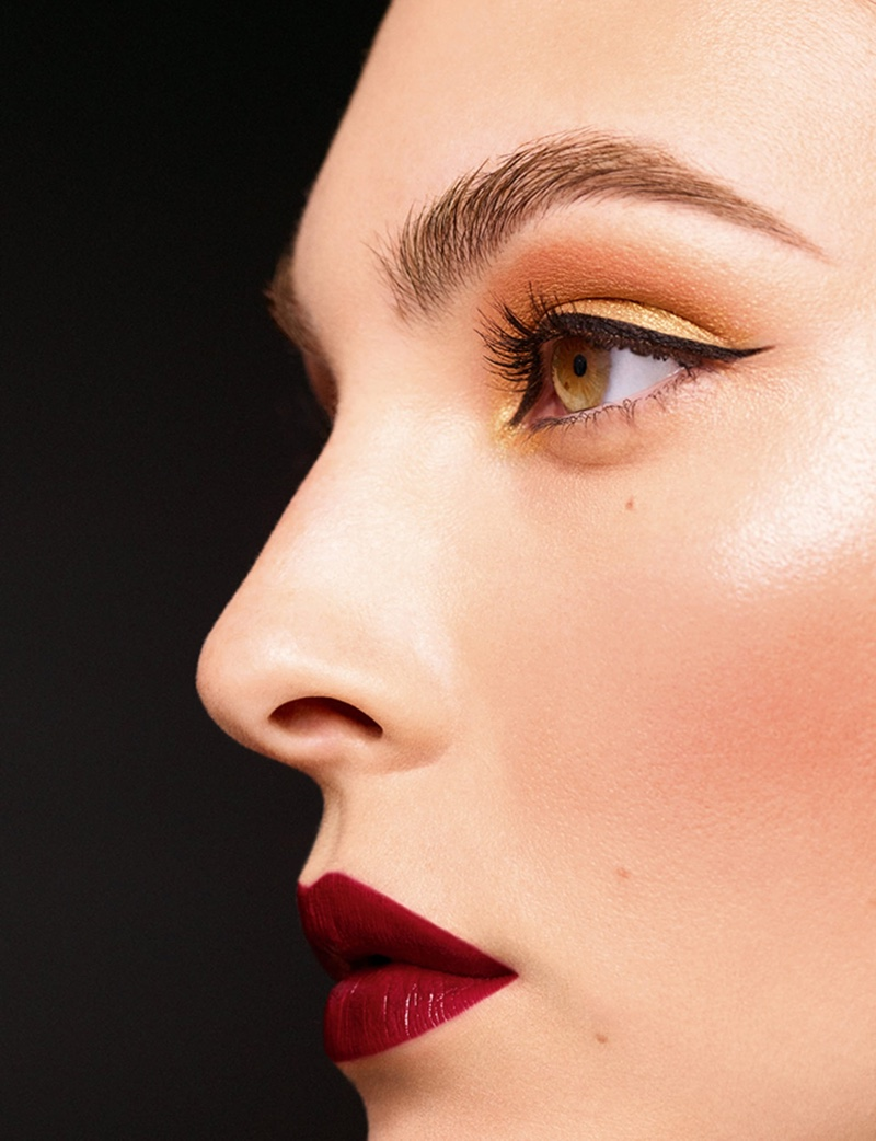 Chanel Makeup highlights burgundy lipstick for Holiday 2020 campaign.