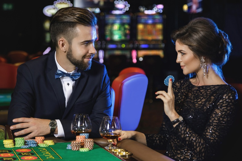 Couple Casino Well Dressed Table Chips Drinks