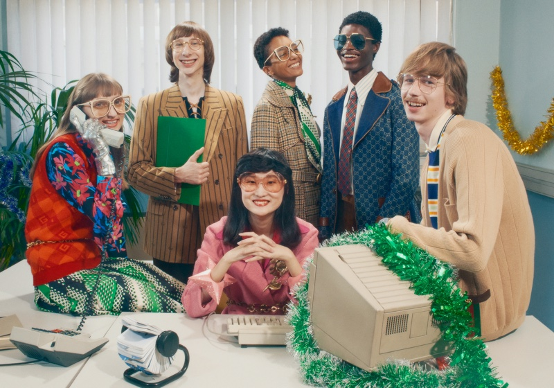 Gucci sets its Holiday 2020 campaign at a festive office party.